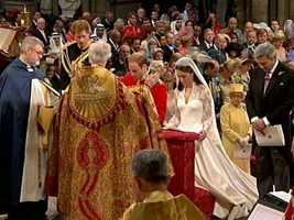 The couple kneeling before the archbishop.