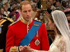 Followed by William placing a gold ring on Kate's finger.