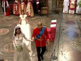 Sister Kate helping HRH with her train as the couple left the altar to sign papers.