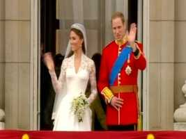 William and Catherine on the balcony, greeting their subjects.