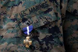 U.S. Marine Sgt. William Soutra Jr. wears the Navy Cross during a ceremony held at Camp Pendleton, Calif., Monday, Dec. 3, 2012. Soutra was awarded the medal for his heroism while serving in Afghanistan.