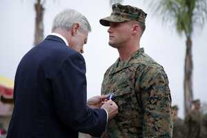 U.S. Marine Sgt. William Soutra Jr., right, receives the Navy Cross from Secretary of the Navy Ray Mabus during a ceremony held at Camp Pendleton, Calif., Monday, Dec. 3, 2012. Soutra was awarded the medal for his heroism while serving in Afghanistan.