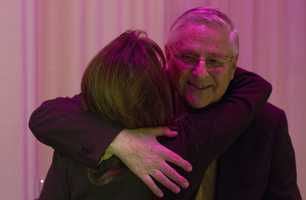 Hugs from the staff of Channel 5 as Dr. Timothy Johnson announces his retirement.