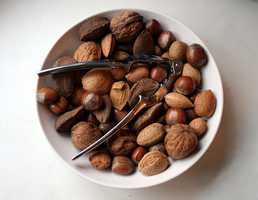 """""""A protein- and fiber-rich snack keeps you energized, gives your body a steady stream of good nutrients to digest (which keeps your metabolism revved), and leaves you less vulnerable to blood sugar swings. Almonds, my favorite, have vitamin E and protein and more fiber than any other nut."""""""