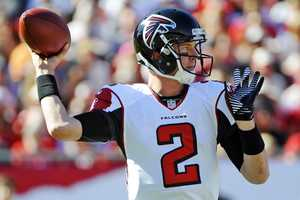 25) Atlanta Falcons - Uni Watch asks 'What's with the sleeve stripes and the side panels?""