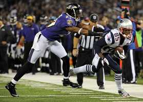 23) Baltimore Ravens - Color coordination is the major gripe with the Ravens.  While the black socks with white pants looks okay in this shot -- what about black socks with black pants?