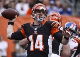 32) Cincinnati Bengals - Uni Watch calls out the number of stripes on the uniform, from the helmet to the shoulders. It also wants to know why these black jerseys have white side panels.  Sometimes - the team wears black pants with the black tops.  Too much black?   Uni Watch urges the team to re-design the whole jersey from scratch.