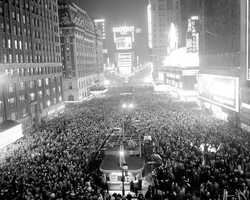 1958 revelers pack the streets.  This view looks north from the Times tower, between 42nd and 43rd Streets.