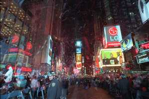 Crowds in 1997.  The Times Square advertisers are now dominated by technology companies.
