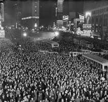 The first New Years celebration was held in Times Square in 1904. The famous Ball was added in 1907. In this pictures, thousands pack Times Square to greet 1938.
