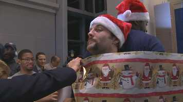Welker is nearly all wrapped up in wrapping paper.