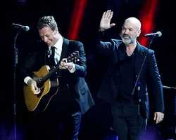 Chris Martin, left, and Michael Stipe at the 12-12-12 The Concert