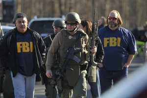 Law enforcement officials speaking on condition of anonymity said that Adam Lanza killed his mother, Nancy Lanza, then drove to the school in her car with at least three guns