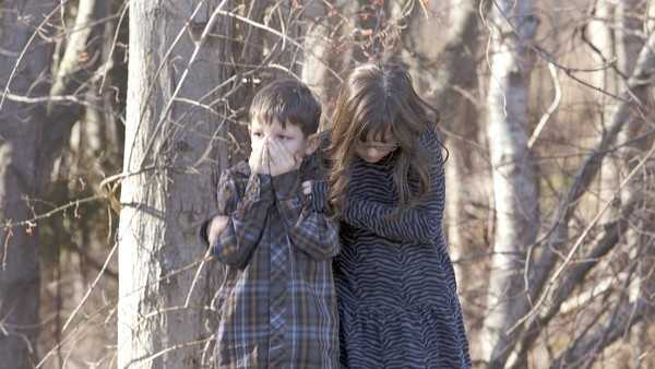 Newtown School Shooting Child Covers Face.jpg