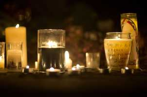 A message is seen on a candle outside the St. Rose of Lima Roman Catholic Church in Newtown, Conn.