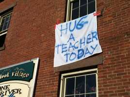 A sign hung on a building Saturday in Newtown.