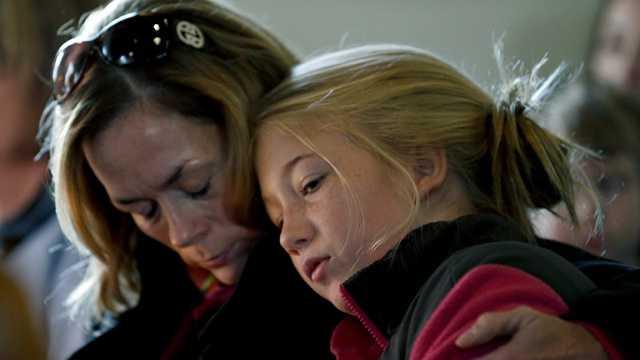 Newtown Mother comforts child.jpg