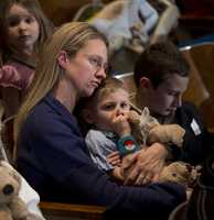 Residents wait for the start of an interfaith vigil for the victims of the Sandy Hook Elementary School shooting
