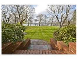 The compound features 200 feet of lake frontage.
