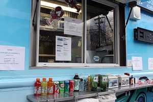 Employees were encouraged to make a donation as they voted for their favorite food truck.
