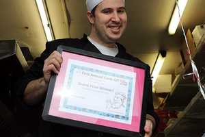 Avi Shemtov of the Chubby Chic Pea holds the certificate at the winner.