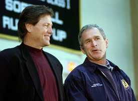 Republican presidential hopeful Texas Gov. George W. Bush and Major League Baseball Hall of Famer Carlton Fisk stand together during a Bush campaign stop at Souhegan High School in Amherst, N.H., Jan. 27, 2000.