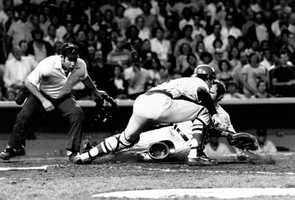New York Yankees catcher Thurman Munson slides safely home past Boston Red Sox catcher Carlton Fisk in sixth inning of a game at Yankee Stadium, Aug. 3, 1978. The umpire is Al Clark. Munson scored on the sacrifice fly by Graig Nettles.