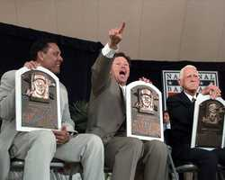 The newest members of the National Baseball Hall of Fame, from left, Tony Perez, Carlton Fisk and Sparky Anderson, display their plaques at the conclusion of the induction ceremonies, July 23, 2000 in Cooperstown, N.Y.