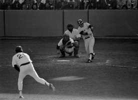 New York Yankees Bucky Dent hits a home run off a pitch from Boston Red Sox Mike Torrez in the seventh inning of Oct. 2, 1978 American League playoff game at Fenway Park. Boston catcher is Carlton Fisk, and umpire is Don Denkinger.