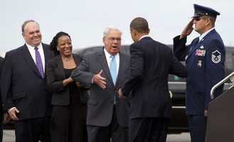 President Barack Obama is greeted by Boston Mayor Thomas Menino, center, as he steps off of Air Force One as he arrives at Boston Logan International Airport, June 25, 2012.