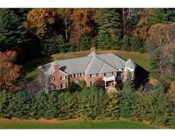 The home is sited at the end of private tree-lined driveway.