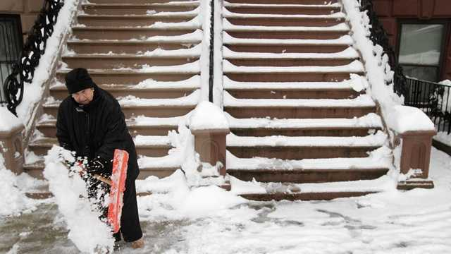 Snow woman shovels steps.jpg