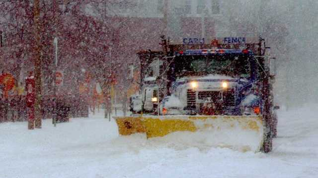 Snow plow in storm.jpg