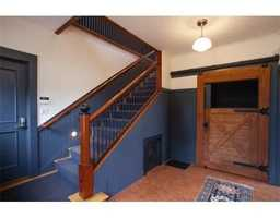 The home has a renovated carriage house with an office.