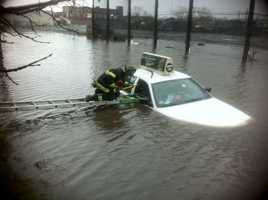 The driver of a cab that got stuck in a flooded area of Vale Street in Everett is doing well after getting stuck Thursday morning.