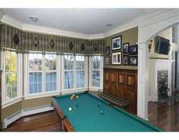 Billiards room with coffered wood ceiling.
