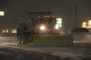 A snowplow stopped for a light along Route 1 in Walpole.