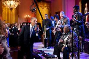 Feb. 21, 2012 -- Egged on by B.B. King, at right, the President joins in singing 'Sweet Home Chicago' during the 'In Performance at the White House: Red, White and Blues' concert in the East Room. Participants include, from left: Troy 'Trombone Shorty' Andrews, Jeff Beck, Derek Trucks, B.B. King, and Gary Clark, Jr.