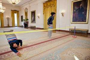 "Jan. 25, 2012 -- First Lady Michelle Obama participating in a potato sack race with Jimmy Fallon in the East Room of the White House during a ""Late Night with Jimmy Fallon"" taping for the second anniversary of the ""Let's Move!"" initiative."