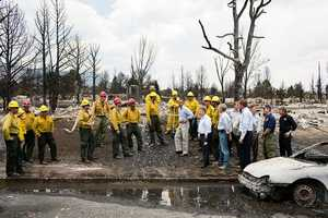 June 29, 2012 - The President views fire damage with firefighters and elected officials in Colorado Springs, Colo., after the devastating wildfires swept through the region the week before.
