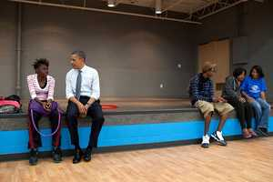 June 14, 2012 - We made an OTR (off-the-record, surprise stop) at the Boys and Girls Clubs of Cleveland after a campaign event, and the President sat and talked to a young woman before shooting hoops with another group of kids