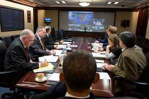 Oct. 29, 2012 - In the White House Situation Room, the President receives an update to the ongoing response to Hurricane Sandy during a teleconference with key officials.