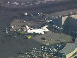 According to Boston Fire, after the plane landed and all passengers had left the plane, a mechanic was doing a walk through of the 787 plane.