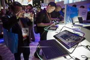 An electronics industry affiliate photographs Dell's XPS Ultrabook convertible.