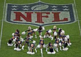 Cheerleaders perform prior to a NFL football game between the St. Louis Rams and New England Patriots at Wembley Stadium, London, Sunday, Oct. 28, 2012.