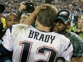 Win #09 - Tom Brady hugs Philadelphia Eagles quarterback Donovan McNabb, following a 24-21 victory in Super Bowl XXXIX in Jacksonville, FL.