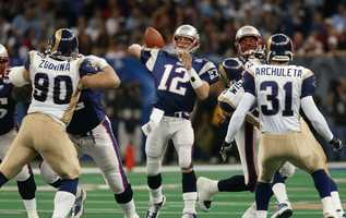 Win #03 - Tom Brady and the New England Patriots were considered big underdogs against the high-powered St. Louis Rams offense. The Patriots defense helped the team build a 14 point lead going into the 4th quarter.   The Rams battled back to tie the game at 17-17 with 1:30 left in the 4th quarter. Tom Brady then led the team on an incredible drive, with clutch passes to Troy Brown and Jermaine Wiggins. With seven seconds left, the Patriots setup Adam Vinatieri for a 48-yard field goal to win the game, 20-17, giving the Patriots their first ever Super Bowl victory.