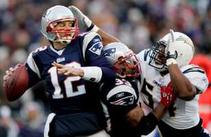 Win #14 - Despite 3 interceptions from Tom Brady, the Patriots still managed to defeat San Diego, holding them to four field goals while Laurence Maroney rushed for 122 yards and a touchdown for the second game in a row.  The Patriots beat the Chargers 21-12.