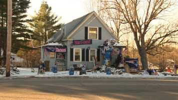 One mega New England Patriots fan from Foxborough put up this spirited display outside their home. It's complete with a PVC goalpost and a giant patriot lifting and tossing a Baltimore Ravens player.