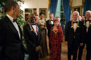 President Barack Obama and First Lady Michele Obama talk with the 2012 Kennedy Center Honorees in the Blue Room of the White House prior to a reception in the East Room, Dec. 2, 2012. Honorees, from left, are: Chicago bluesman Buddy Guy, Led Zeppelin keyboardist and bassist John Paul Jones, Led Zeppelin singer Robert Plant, ballerina Natalia Makarova, actor Dustin Hoffman, Led Zeppelin guitarist Jimmy Page, and television comedian David Letterman.